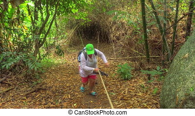 Hiking at the deep jungle of Similan Islands - Woman in the...