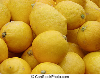 lemons on the market for sale as a background. Selective focus
