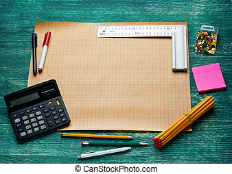 blank page with work tools on wooden background. Top view..