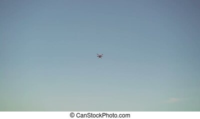 Drone flyes in the sky