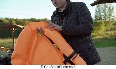 Young man wearing life jacket outdoors