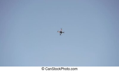 Drone flyes in the sky at the evening