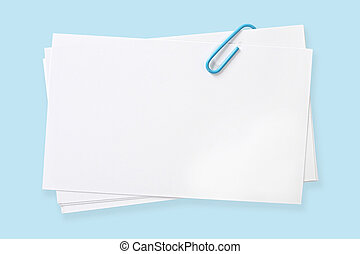 Blank Cards with Blue Paperclip - Blank white cards fastened...