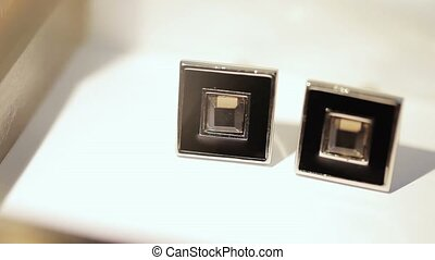 Man's cufflinks on white background closeup