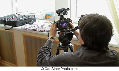 Cameraman shooting makeup brushes - Young cameraman shooting...