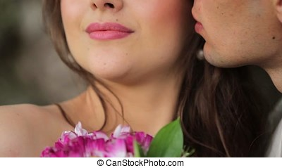 Man kissing woman - Man kissing young woman unrecognizable