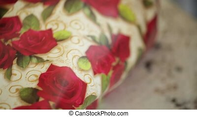 Woman gift pack in paper closeup
