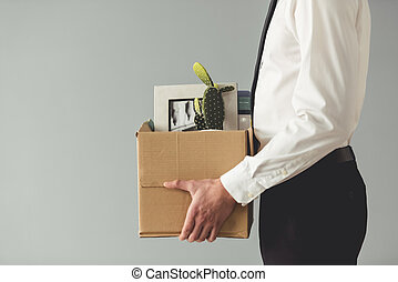 Businessman getting fired - Getting fired. Cropped image of...