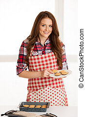 Woman baking cookies in the kitchen