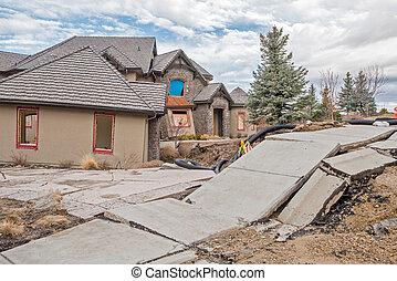 Broken sidewalk and home from Boise landslide - Foothills...