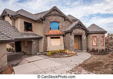 Crumbling home from a natural disaster Landslide - Landslide...