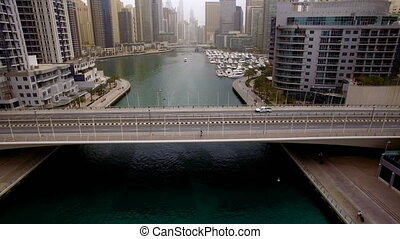 flying over a highway bridge across the river in Dubai, UAE