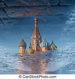 St. Basil's Cathedral on Red square in spring day reflected...