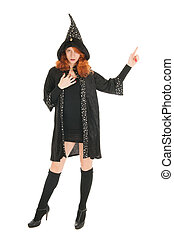 Evil witch - Young woman with red hair pointing with finger...