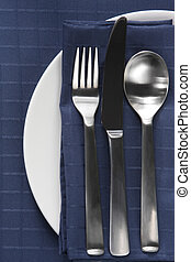 Place Setting - Place setting with cutlery on white plate,...