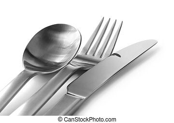 Cutlery, on white, in soft-focus