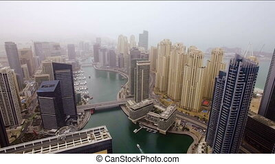 beautiful aerial view on bay with yachts and embankment among the skyscrapers in Dubai, UAE