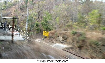 Travelling by rail. Spurs of plateau Deccan. India -...