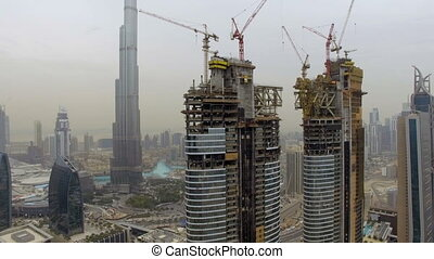 aerial view of several skyscrapers under construction with...