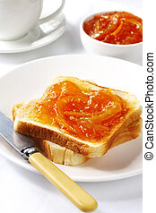 Marmalade on Toast - Breakfast of orange marmalade on toast,...