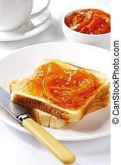 Marmalade on Toast - Breakfast of orange marmalade on toast,...