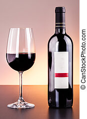 Luxury red wine - a blank labeled bottle of wine and a glass...
