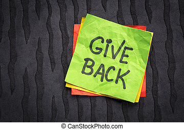 give back inspirational reminder - handwriting on a sticky...