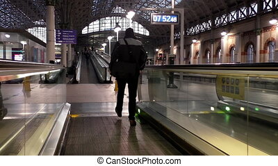 Moving walkway or sidewalk at rail station - Handheld camera...