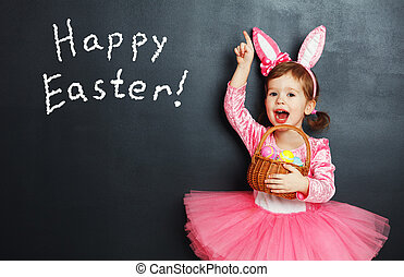 Happy easter! Child with bunny ears and eggs. - Happy...