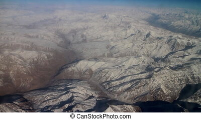 Flight over Pamir and Tien Shan 2. Visible deep mountain...