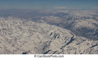 Flight over Pamir and Tien Shan 4. Visible deep mountain...