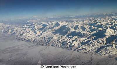 Flight over Pamir and Tien Shan 5. Visible deep mountain...
