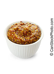 Mustard - Small white bowl of whole-grain seeded mustard,...