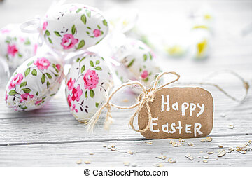 Easter composition with eggs and the words happy Easter is...
