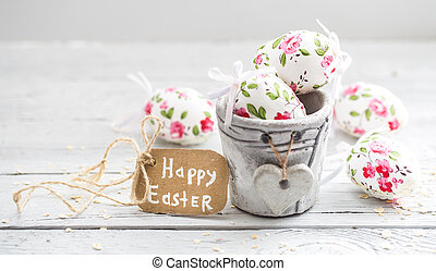 Easter composition with eggs in a bucket and with the...