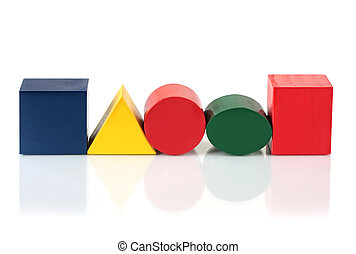 Block Shapes - Wooden block shapes in a row, reflected on...