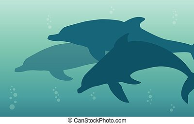 Silhouette of dolphin on the ocean landscape