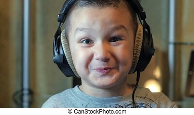 Boy listening to music in big headphones