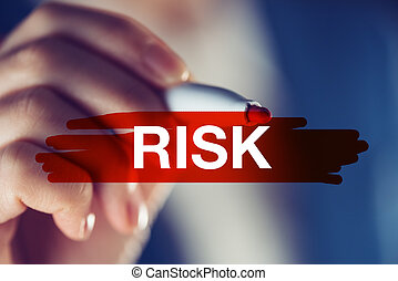 Risk in business concept, businesswoman marking the word...