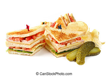 Club Sandwiches - Club sandwiches with potato chips and a...