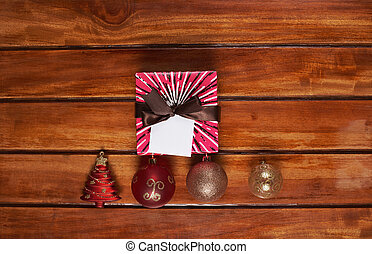 Present colour box on wood table view from top. Christmas...