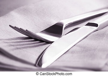 Knife and Fork - Knife and fork on napkin Close-up view,...