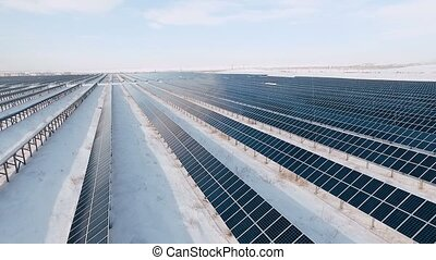 solar power plant on the outskirts of the city on a cold...