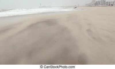 Sand on the beach going with the wind. - Sandstorm by strong...