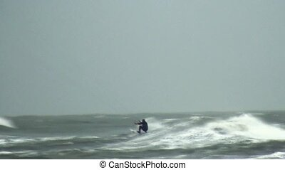 Kitesurfer in high waves - Surfing in the sea by strong...