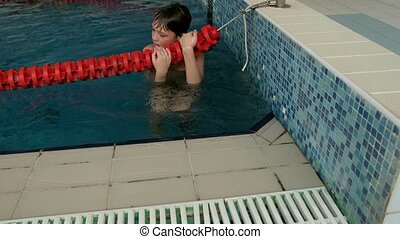 bad boy swims in the pool - young man jumping in the pool,...