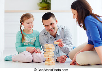 happy family playing jenga game at home