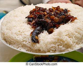 Cooked rice with fried onions and raisins