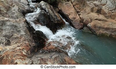 Waterfall Scene - A waterfall scene surrounded with large...