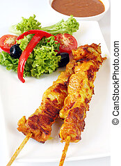 Satay Chicken - Satay chicken kebabs with a side salad and...